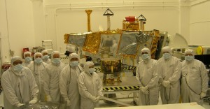 CERES instrument and team members  (foreground) and the NPP spacecraft, background Photo courtesy Ball Aerospace Corporation